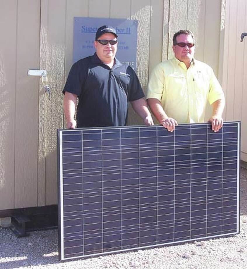 John May, left, and Billy Rose say the Solar Energy Generator captures waste pumpjack energy and solar power to reduce pumpjack electrical costs by up to 40 percent. Call 432-413-7153 to find out how.