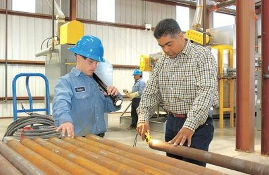 Permian Enter­prise's internal plastic coatings (IPC) are designed to protect your pipe from the harshest downhole condi­tions. Roy Pickett, left, the company's director of develop­ment, helps make sure everything is done just right. Call 432-332-0903.