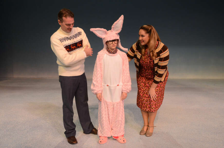 """The Old Man (Matthew Nicholson), Ralphie Parker (Brock Bizzell) and Mother (Jenna Petty) rehearse for Midland Community Theatre's production of """"A Christmas Story"""" on Thursday at MCT. James Durbin/Reporter-Telegram"""