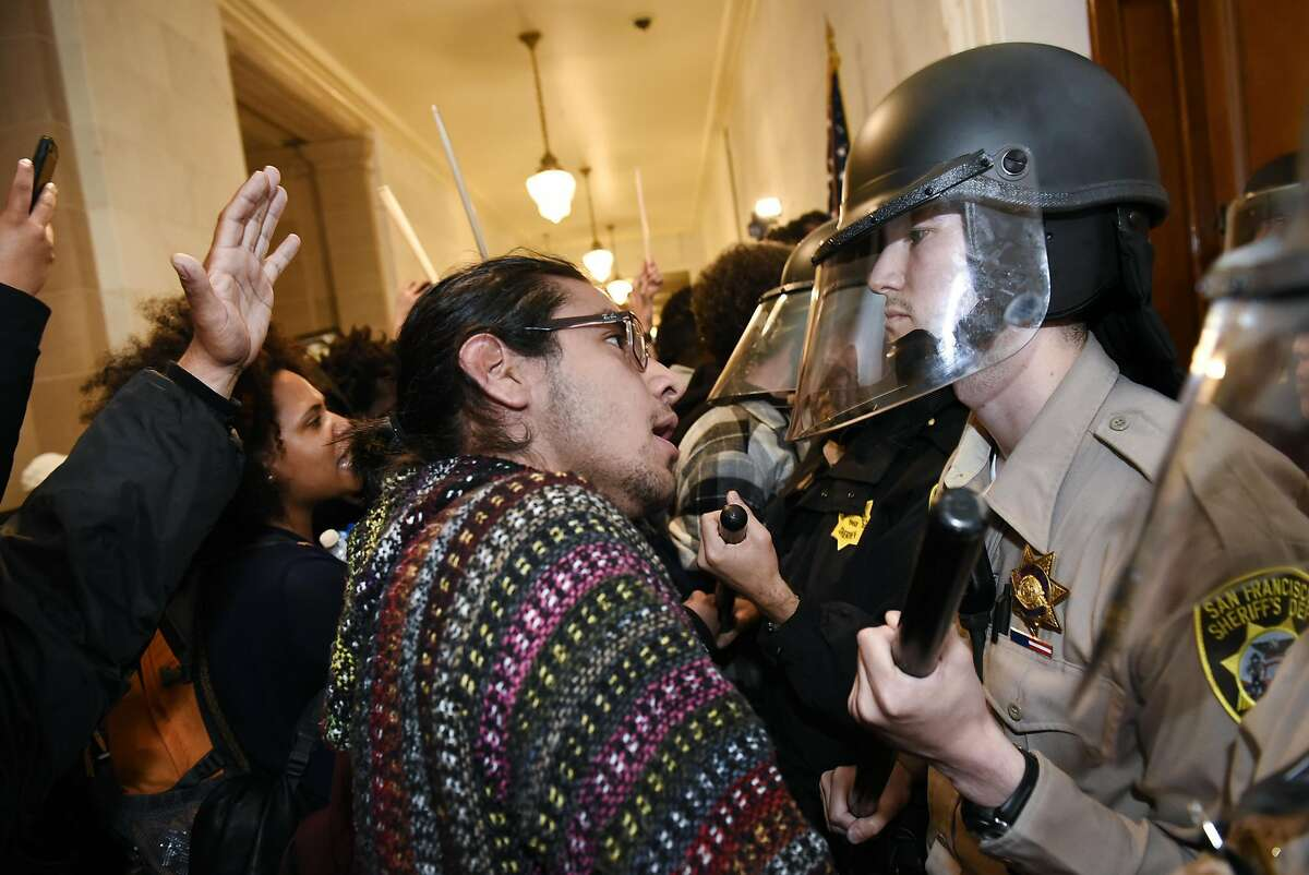 """Protesters supporting the """"Frisco Five"""" hunger strikers clash with police officers in front of the mayors office at City Hall in San Francisco in San Francisco, CA, Friday, May 6, 2016."""