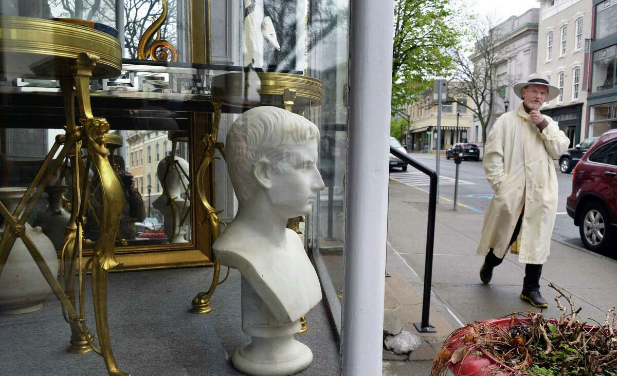 A man walks past a window display in the Theron Ware Gallery on Warren Street Tuesday May 3, 2016 in Hudson , NY. (John Carl D'Annibale / Times Union)