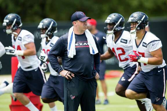 Houston Texans head coach Bill O'Brien watches as he players warm up during rookie mini camp at The Methodist Training Center on Saturday, May 7, 2016, in Houston.