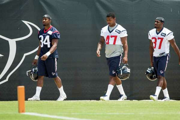 Houston Texans running back Tyler Ervin (34), cornerback Jimmy Pruitt (47), cornerback Cleveland Wallace III (37) and cornerback Richard Leonard (38) walk onto the practice field during rookie mini camp at The Methodist Training Center on Saturday, May 7, 2016, in Houston.