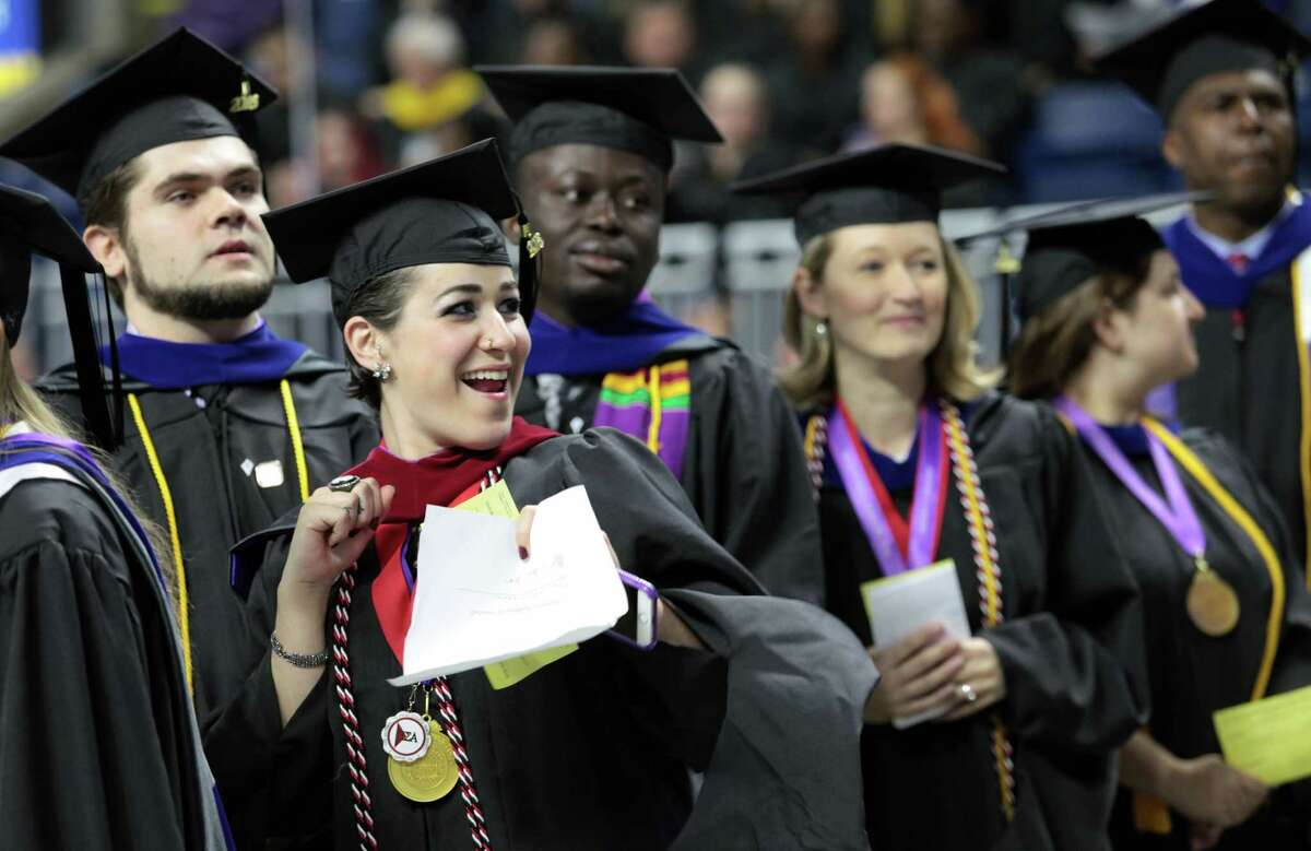 Janaina Bordignon, of Woodbridge, celebrates during the University of Bridgeport 's106th Commencement Ceremony at the Webster Bank Arena, in Bridgeport, Conn. on Saturday, May 7, 2016.