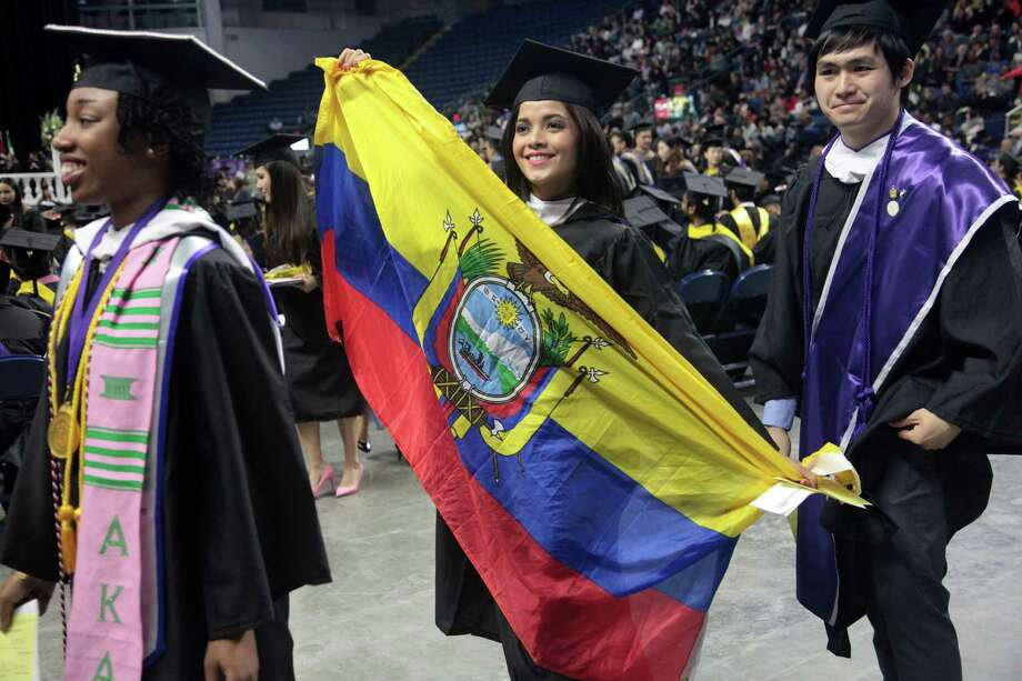 Graduate Adriana Onate-Troya, of Ecuador, holds the Ecuadorian flag  during the University of Bridgeport 's 106th Commencement Ceremony at the Webster Bank Arena, in Bridgeport, Conn. on Saturday, May 7, 2016. Photo: BK Angeletti, For Hearst Connecticut Media / Connecticut Post freelance B.K. Angeletti