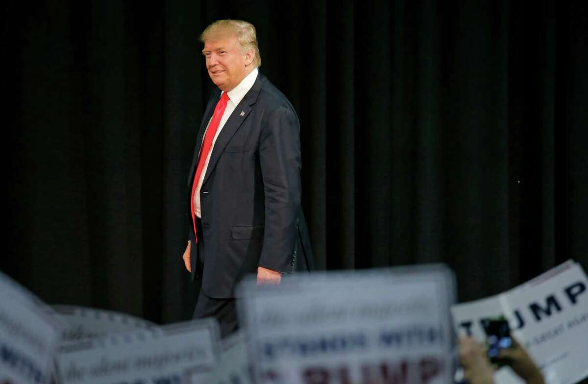 Republican presidential candidate Donald Trump looks over the crowd before speaking at a rally in Eugene, Ore., Friday, May 6, 2016. (AP Photo/Ted S. Warren)