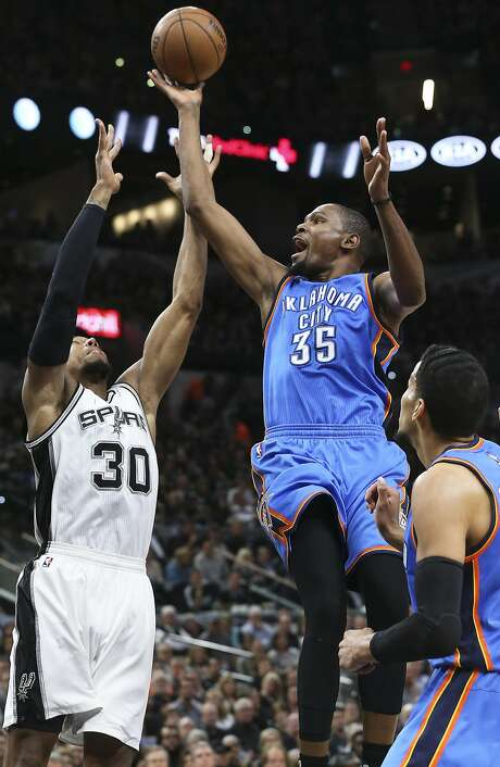 The Thunder's Kevin Durant shoots over the Spurs' David West in Game 2 of their playoff series. It's possible Durant, a free-agent-to-be, could be on San Antonio's roster next season. Photo: TOM REEL, SAN ANTONIO EXPRESS-NEWS