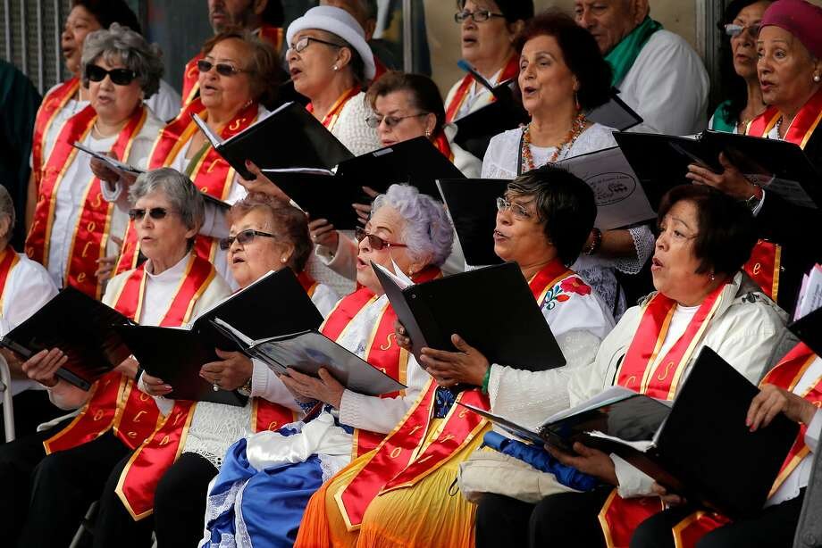 The Adult choir of the Community Music Center of the Mission performs to a small audience during the Cinco de Mayo Festival despite the downpour of rain that put a dampen on the celebration along Valencia St. in the Mission neighborhood  of San Francisco, California, on Sat. May 7, 2016. The Community Music Center's older adult choir is for those 55 years old and above with a desire to sing. Photo: Michael Macor / The Chronicle