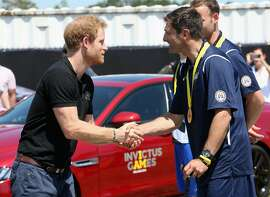 ORLANDO, FL - MAY 07:  Prince Harry presents medals during the Jaguar Land-Rover Driving Challenge at Invictus Games Orlando 2016 at ESPN Wide World of Sports on May 7, 2016 in Orlando, Florida. Prince Harry, patron of the  Invictus Games Foundation is in Orlando ahead of the opening of Invictus Games which will open on Sunday. The Invictus Games is the only International sporting event for wounded, injured and sick servicemen and women. Started in 2014 by Prince Harry the Invictus Games uses the power of Sport to inspire recovery and support rehabilitation.  (Photo by Chris Jackson/Getty Images for Invictus)
