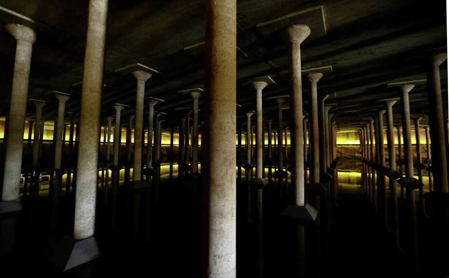 The inside of the Buffalo Bayou Park Cistern is shown Monday, April 25, 2016, in Houston.  Built in1927, it was the City of Houstoné•s first underground drinking-water reservoir- a concrete holding tank roughly the size of one and half football fields on Sabine Street, near Buffalo Bayou. ( Melissa Phillip / Houston Chronicle ) Photo: Melissa Phillip, Staff / © 2016 Houston Chronicle