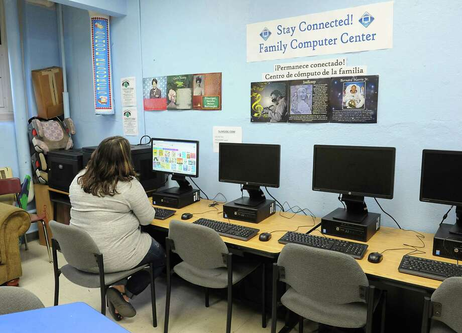 Parent Jess Kanciruk Of Schenectady Is Seen On A Computer In The Resource Room At
