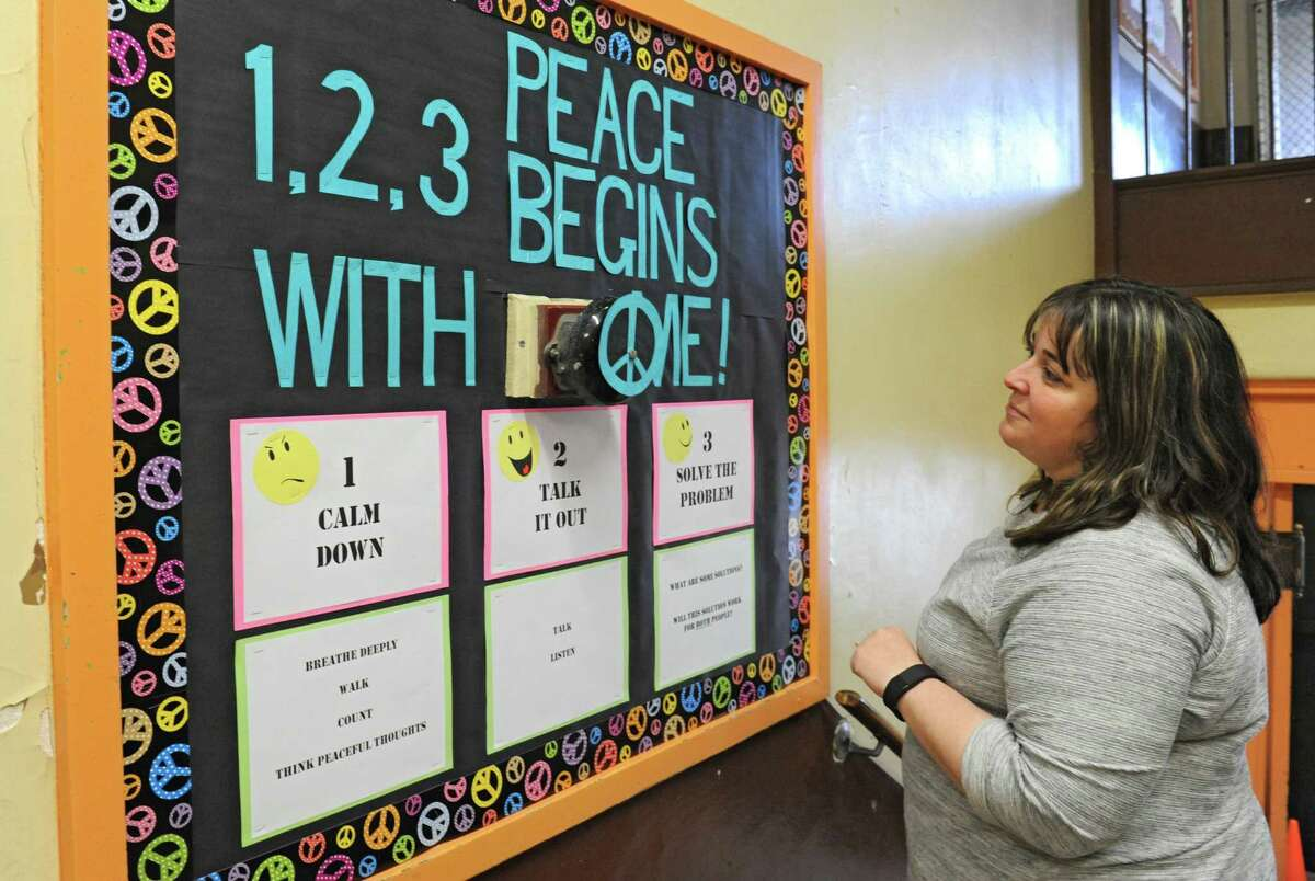 Parent Jess Kanciruk of Schenectady looks at the bulletin board she put together at Lincoln Elementary on Friday, May 6, 2016 in Schenectady, N.Y. The school is eligible for community school grant money. (Lori Van Buren / Times Union)