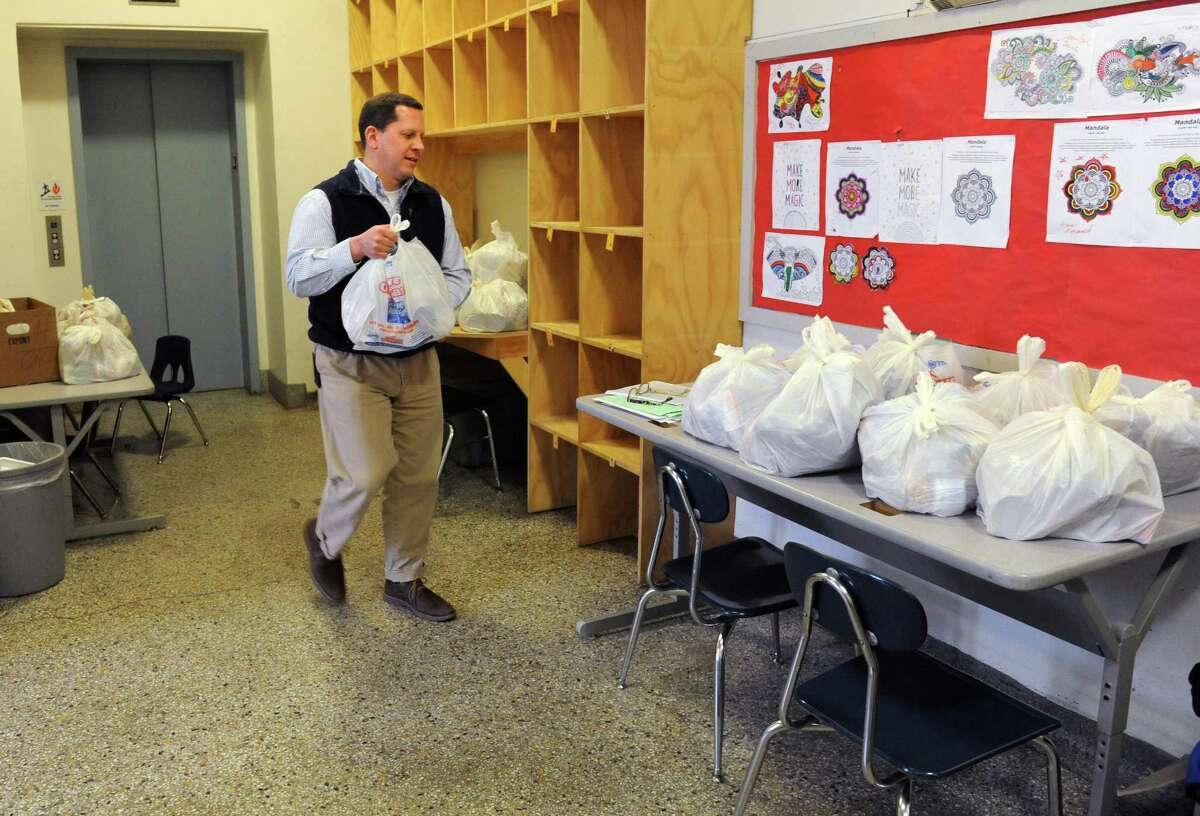 Community School Director Larry Grimmer works in the food pantry area at Lincoln Elementary on Friday, May 6, 2016 in Schenectady, N.Y. The school is eligible for community school grant money. (Lori Van Buren / Times Union)