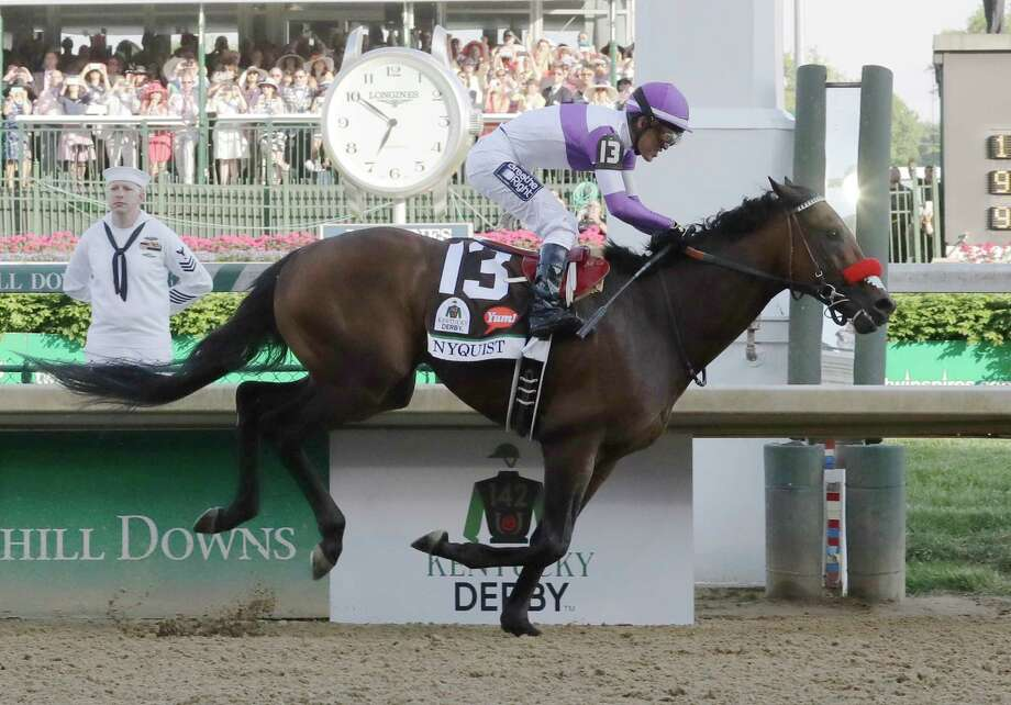 Mario Guitierrez rides Nyquist to victory during the 142nd running of the Kentucky Derby horse race at Churchill Downs Saturday, May 7, 2016, in Louisville, Ky. (AP Photo/Morry Gash) ORG XMIT: DBY155 Photo: Morry Gash / AP