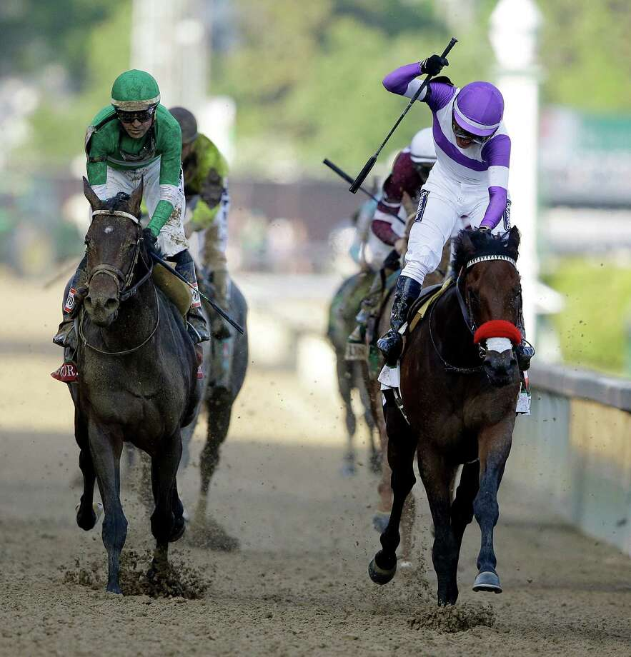 Mario Guitierrez rides Nyquist to victory during the 142nd running of the Kentucky Derby horse race at Churchill Downs Saturday, May 7, 2016, in Louisville, Ky. (AP Photo/Darron Cummings) ORG XMIT: DBY161 Photo: Darron Cummings / AP