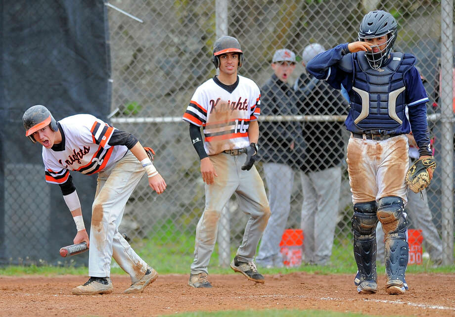 Stamford Jay DeVito (2) andDanny Collazo (10) celebrate scoring the go ahead runs in the botton of the fifth inning of a baseball game against Wilton in Stamford on Saturday, May 7, 2016. The Black Knight dou scored on an throwing error to first base in attempt to get batterJorge Lopez out. At right is Wilton catcher Jack DiNanno. Photo: Matthew Brown / Hearst Connecticut Media / Stamford Advocate