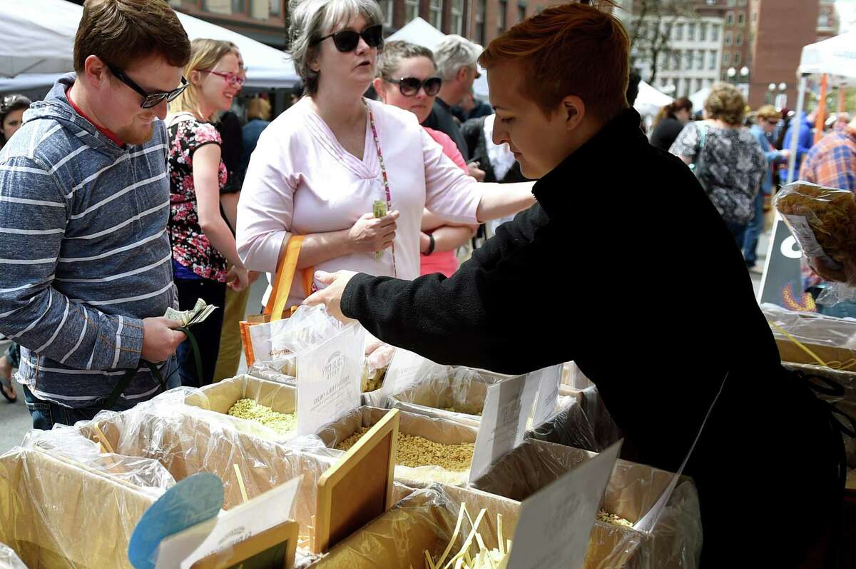 Vendor Jess Bennett, right, sells fresh pasta at the Flour City Pasta booth at the Troy Waterfront Farmers' Market on Saturday, May 7, 2016, in Troy, N.Y. (Cindy Schultz / Times Union)