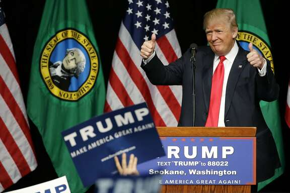 Republican presidential candidate Donald Trump greets supporters as he arrives for a rally in Spokane, Wash., Saturday, May 7, 2016. (AP Photo/Ted S. Warren)