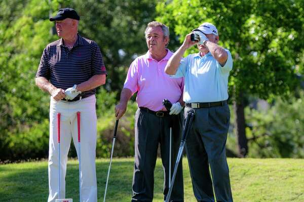 Golf Great's Tom Weisskopf, left, David Graham, center, and Tony Jacklin while Jacklin looking through the range finder in 16-hole during the second round of the Insperity Invitational Golf at the Woodlands Country Club, Saturday, May 7, 2016, in Houston. (Juan DeLeon / For the Houston Chronicle)