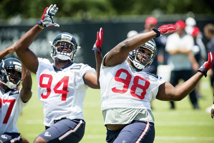 Houston Texans defensive end Ufomba Kamalu (94) and nose tackle D.J. Reader (98) stretch during rookie mini camp at The Methodist Training Center on Friday, May 6, 2016, in Houston. ( Brett Coomer / Houston Chronicle )