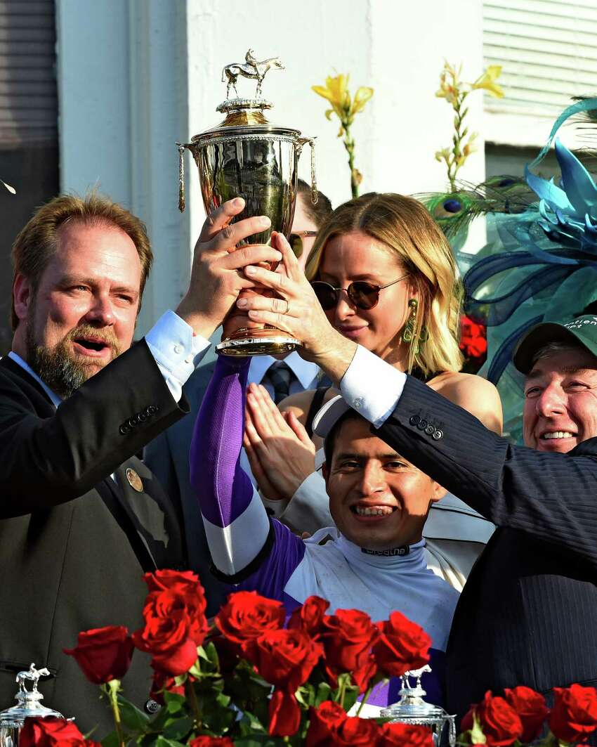 Trainer Doug O'Neill, left, jockey Mario Gutierrez, center, and owner J. Paul Reddam hold up the winner's trophy after Nyquist won the 142nd running of the Kentucky Derby May 7, 2016 at Churchill Downs in Louisville, Ky. (Skip Dickstein/Times Union)