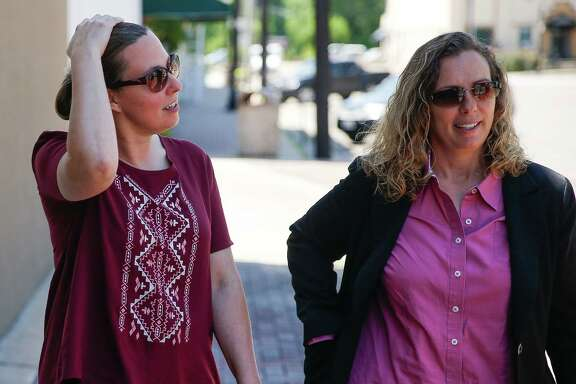 Foster parents Carol Jeffery, left, and Angela Sugarek were frustrated after a court hearing in Wharton. Their two foster children were taken away after they reported evidence of possible sexual abuse by the boys' 15-year-old half-brother following required visits.