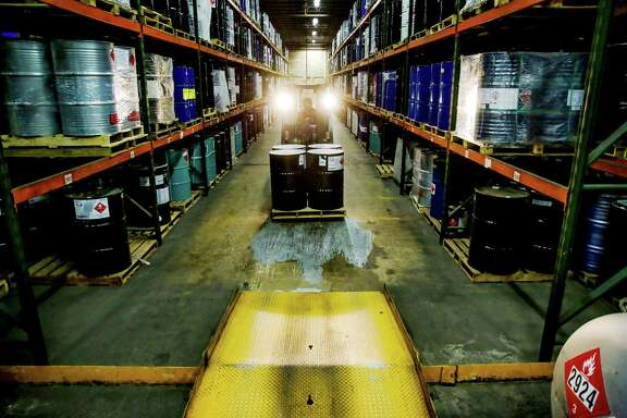 Forklift operator Jose Flores drives a pallet of toxic chemicals stored at Palmer Logistics through the warehouse Wednesday, Nov. 25, 2015, in Houston. ( Michael Ciaglo / Houston Chronicle )