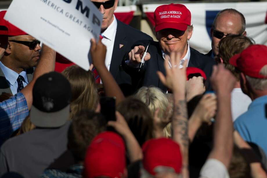 Presumptive Republican presidential candidate Donald Trump points at a supporter while shaking hands following a rally at the Northwest Washington Fair and Event Center in Lynden, Washington on Saturday, May 8, 2016. Photo: GRANT HINDSLEY, SEATTLEPI.COM