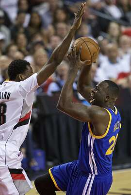 Golden State Warriors forward Draymond Green, right, shoots over Portland Trail Blazers forward Al-Farouq Aminu, left, during the first half of Game 3 of an NBA basketball second-round playoff series Saturday, May 7, 2016, in Portland, Ore. (AP Photo/Craig Mitchelldyer)