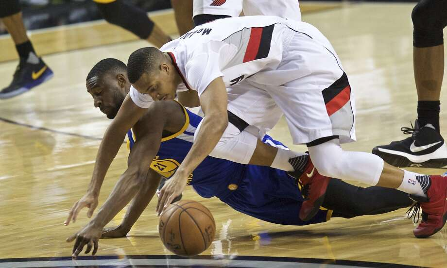 Portland Trail Blazers guard C.J. McCollum, right, and Golden State Warriors guard Ian Clark, left, dive for a loose ball during the first half of Game 3 of an NBA basketball second-round playoff series Saturday, May 7, 2016, in Portland, Ore. (AP Photo/Craig Mitchelldyer) Photo: Craig Mitchelldyer, Associated Press