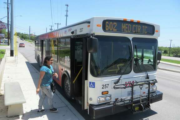 San Antonio resident Rosa Rangel boards a VIA bus in Castle Hills, where she regularly travels by bus to drop off or pick up her kid with relatives. Castle Hills residents overwhelming voted to keep VIA service in Saturday's election.