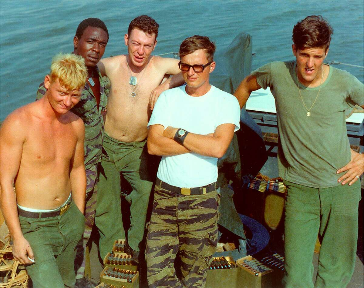"""KRT US NEWS STORY SLUGGED: KERRY KRT PHOTOGRAPH VIA KERRY CAMPAIGN (January 5) (FILE PHOTO) John Kerry (far right) and some of his crew aboard the """"Swift Boat"""" PCF 94 on the Mekong River in Vietnam. (lde) 2004"""