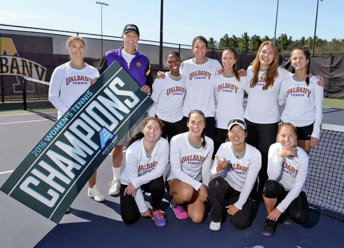Assistant coach Petra Ferancova, left, and head coach Gordon Graham pose with members of the University at Albany tennis team during their