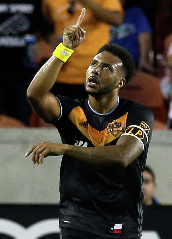 Houston Dynamo Giles Barnes points after scoring during first half of game against Sporting Kansas City at BBVA Compass Stadium Saturday, May 7, 2016, in Houston.  He first pointed to his arm band with the intials LP for Leo Ponce, a fan who the recently passed away and was being honored by the team. Photo: Melissa Phillip, Houston Chronicle / © 2016 Houston Chronicle