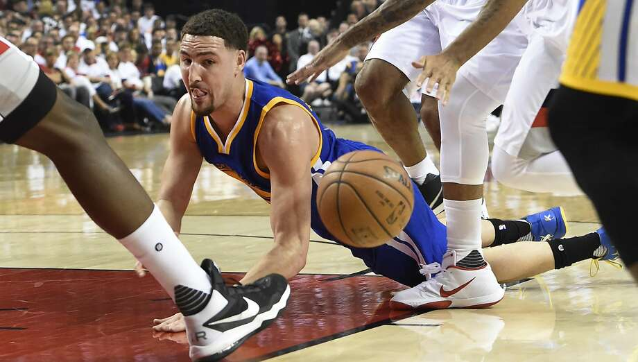 PORTLAND, OR - MAY 7: Klay Thompson #11 of the Golden State Warriors loses control of the ball as he drives to the basket in the first quarter of Game Three of the Western Conference Semifinals against the Golden State Warriors during the 2016 NBA Playoffs at the Moda Center on May 7, 2016 in Portland, Oregon. NOTE TO USER: User expressly acknowledges and agrees that by downloading and/or using this photograph, user is consenting to the terms and conditions of the Getty Images License Agreement.  (Photo by Steve Dykes/Getty Images) Photo: Steve Dykes
