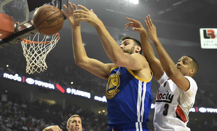 PORTLAND, OR - MAY 7: Andrew Bogut #12 of the Golden State Warriors and C.J. McCollum #3 of the Portland Trail Blazers go after a rebound in the first quarter of Game Three of the Western Conference Semifinals during the 2016 NBA Playoffs at the Moda Center on May 7, 2016 in Portland, Oregon. NOTE TO USER: User expressly acknowledges and agrees that by downloading and/or using this photograph, user is consenting to the terms and conditions of the Getty Images License Agreement.  (Photo by Steve Dykes/Getty Images) Photo: Steve Dykes, Getty Images
