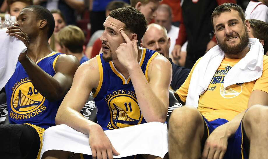 Harrison Barnes #40, Klay Thompson #11and Andrew Bogut #12 of the Golden State Warriors sit on the bench as time winds down in the fourth quarter of Game Three of the Western Conference Semifinals during the 2016 NBA Playoffs at the Moda Center on May 7, 2016 in Portland, Oregon. The Blazers won 120-108. Photo: Steve Dykes, Getty Images