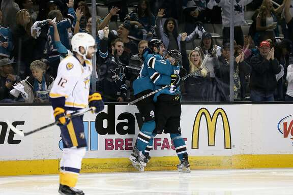 SAN JOSE, CA - MAY 07:  Logan Couture #39 of the San Jose Sharks is congratulated by Joonas Donskoi #27 after he scored a goal against the Nashville Predators in the second period of Game Five of the Western Conference Second Round during the 2016 NHL Stanley Cup Playoffs at SAP Center on May 07, 2016 in San Jose, California.  (Photo by Ezra Shaw/Getty Images)