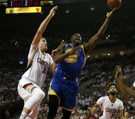 The Golden State Warriors' Draymond Green (23) takes a shot against the Portland Trail Blazers' Mason Plumlee (24) in the second quarter of Game 3 in the Western Conference semifinals at the Moda Center in Portland, Ore., on Saturday, May 7, 2016. The Blazers won, 120-108, to trim the Warriors' series lead to 2-1. (Nhat V. Meyer/Bay Area News Group/TNS)