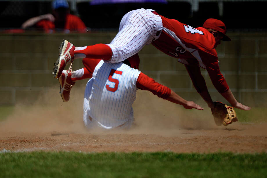 Lumberton's Josh Ward slides safely into home as Crosby pitcher Nathan Gabryszwski collides with him in the Region III-5A bi-district playoff series on Saturday.  Photo taken Saturday 5/7/16 Ryan Pelham/The Enterprise Photo: Ryan Pelham / ©2016 The Beaumont Enterprise/Ryan Pelham