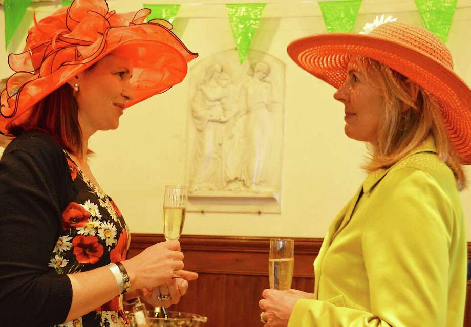 Michelle Adams, left, and Kristen Adams, both of Fairfield, are not related but became fancy-hat friends at the Derby Day celebration hosted by the Pequot Library. Photo: Fairfield Citizen / Jarret Liotta / Fairfield Citizen
