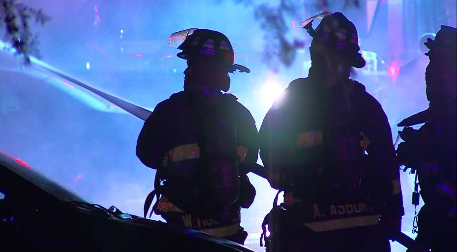 Firefighters battle an apartment fire on the South Side Sunday, May 8, 2016. Two people were injured and several families displaced by the blaze. Photo: Pro 21 Video