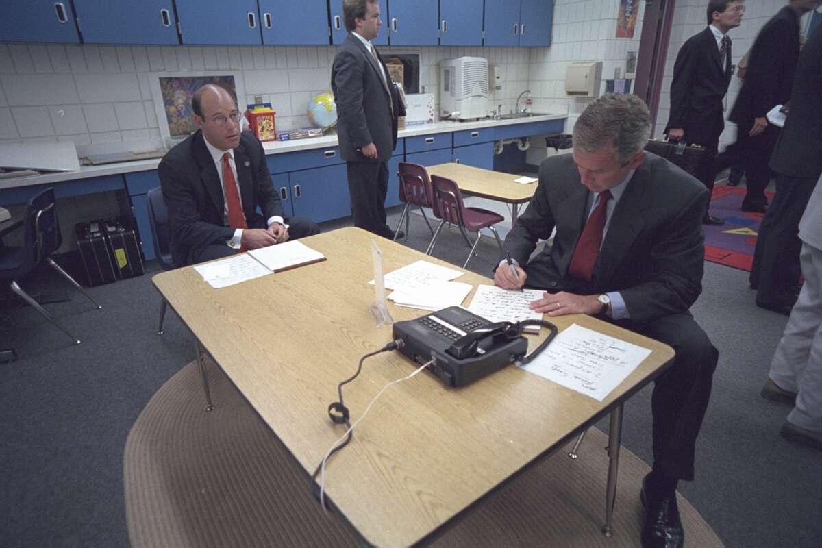 """The president and his staff, including Press Secretary Ari Fleischer, pictured left, were then brought to a holding room at the school, where he prepared to address the nation. """"I have spoken to the vice president, to the governor of New York, to the director of the FBI, and have ordered that the full resources of the federal government go to help the victims and their families - and to conduct a full-scale investigation to hunt down and to find those folks who committed this act,"""" he said. """"Terrorism against our nation will not stand."""" ViaPBS."""