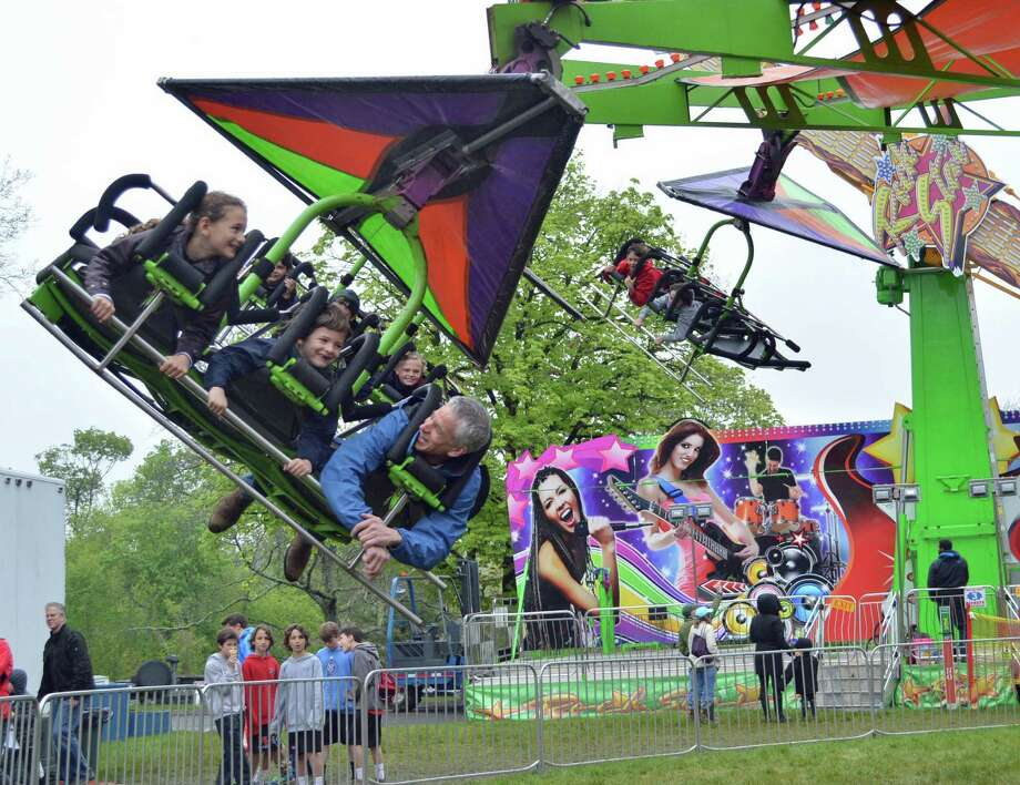The Cliffhanger was just one of the rides tantalizing visitors to this weekend's May Fair. Photo: Jarret Liotta / Hearst Connecticut Media / New Canaan News  freelance