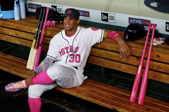 Houston Astros center fielder Carlos Gomez (30) in the dugout before the start of the first inning of an MLB baseball game at Minute Maid Park, Sunday, May 8, 2016, in Houston.