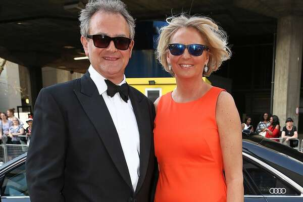 LONDON, ENGLAND - MAY 08:  Hugh Bonneville and Lulu Williams arriving in a Audi at the top of the red carpet for the BAFTA TV Awards 2016 at the Royal Festival Hall  on May 8, 2016 in London, England.  (Photo by David M. Benett/David M. Benett/Getty Images for Audi)