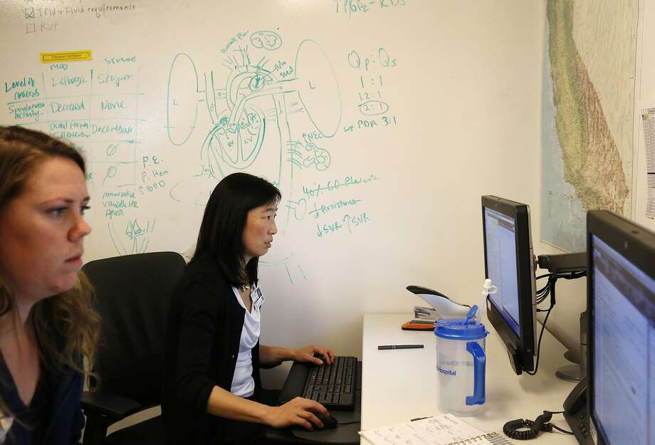 UCSF Dr. Yvonne Wu (right) works with nurse practitioner Kacy Minot. The pediatric neuro logist led the study on the treatment of a condition that causes brain damage in newborns. Photo: Leah Millis, The Chronicle