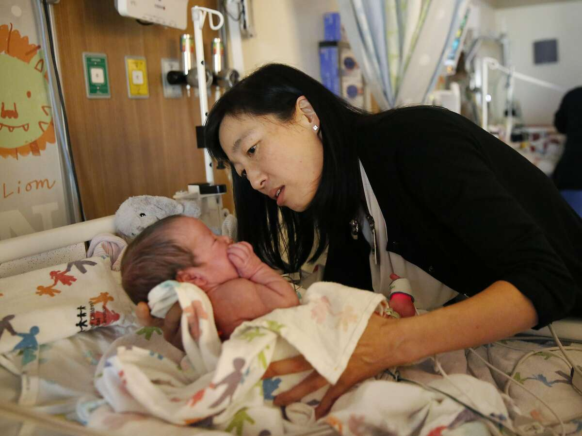 Dr. Yvonne Wu does a routine examination on a premature baby who does not suffer from HIE and who is neurologically normal while doing her regular rounds at UCSF Medical Center at Mission Bay May 4, 2016 in San Francisco, Calif. Dr. Wu, a pediatric neurologist at UCSF Beinoff Children's Hospital, has led a study looking at the effectiveness of the drug erythropoietin or EPO on preventing newborn brain damage caused from Hypoxic-Ischemic Encephalopathy or HIE. HIE is a dysfunction of the nervous system brought on by mysterious birth complications that result in an inadequate flow of blood and oxygen to the brain and other organs, causing brain damage.