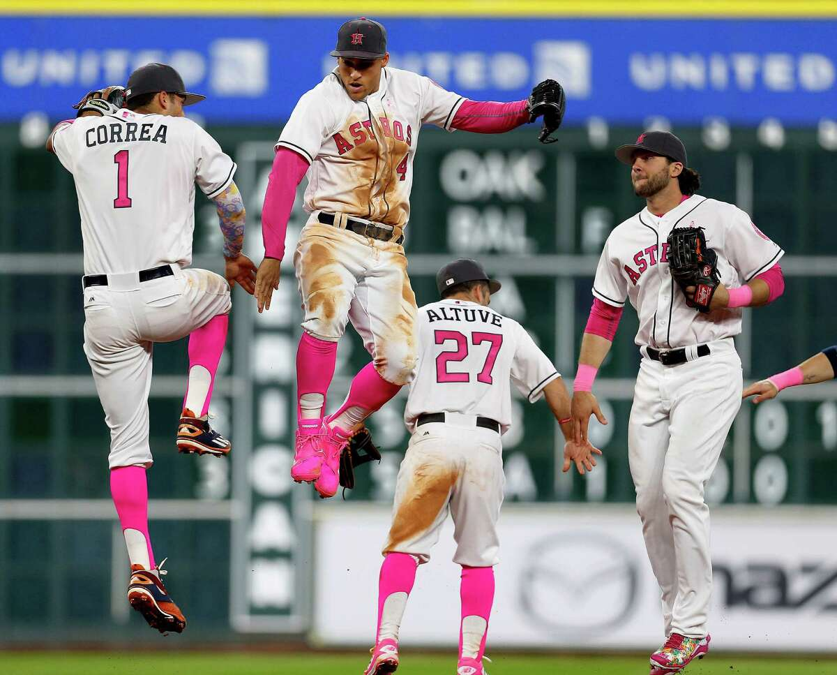 May 8: Astros 5, Mariners 1 Houston Astros George Springer (4) Carlos Correa (1) celebrate the Astros 5-1 win over the Seattle Mariners after an MLB baseball game at Minute Maid Park, Sunday, May 8, 2016, in Houston.
