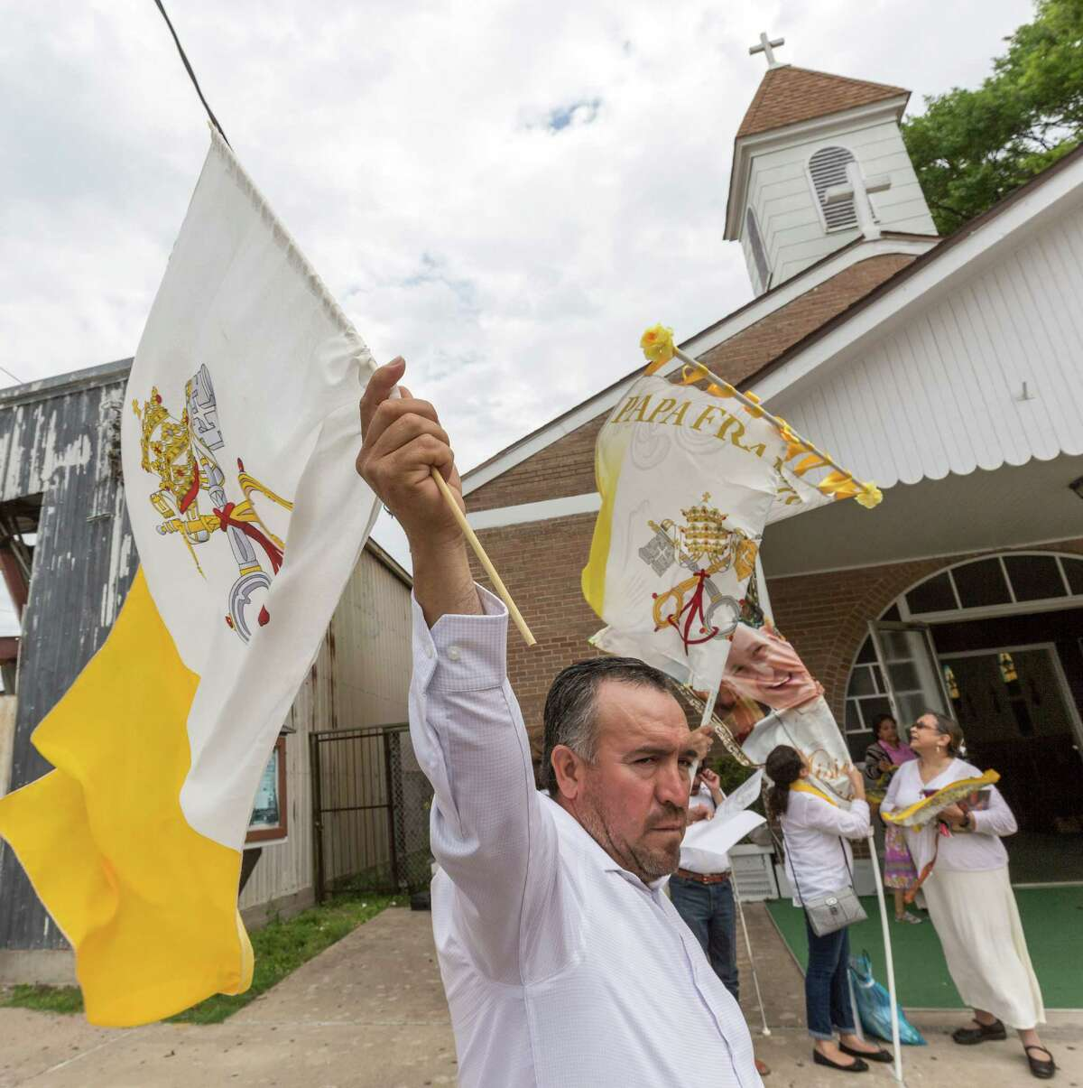Church-goers and well-wishers arrived throughout the morning to protest the merger of two Catholic churches and the loss of their beloved St. Stephen Catholic Church, 1912 Center Street. A request has been sent to the Pope to save the church. ID: Raul Perez shows a determined face as part of the protest. Sunday April 8, 2016